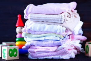 baby clothes  and toys on a table